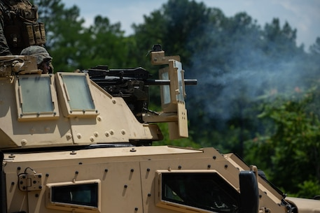 A U.S. Marine with 2d Combat Logistics Battalion (CLB), 2d Marine Division fires an Mk 19 grenade launcher during a live-fire range at Fort A.P. Hill, Virginia, July 17, 2020. Marines with CLB are training with 2d Battalion, 2d Marine Regiment in a simulated realistic setting and environment to improve combat effectiveness and readiness. (U.S. Marine Corps photo by Lance Cpl. Reine Whitaker)