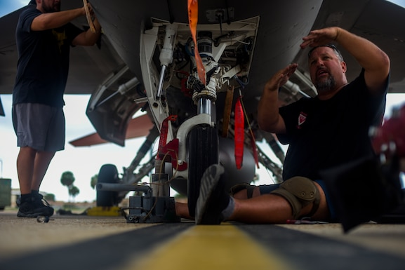 Michael Reeves with the 82nd Aerial Targets Squadron, contractor, works to replace the front landing tire on a QF-16 at Tyndall Air Force Base, Florida, July 9, 2020. The 82nd ARTS contractors fulfill a variety of different flight line technical skills, including replacing old or malfunctioning landing gear. (U.S. Air Force photo by Staff Sgt. Magen M. Reeves)