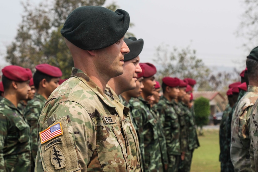 U.S., Thai soldiers stand in formation.