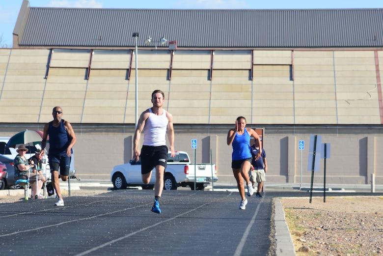 Airmen run on a track.