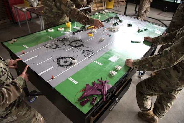 U.S. Air Force Airmen participate in a table top demonstration during Silver Flag
