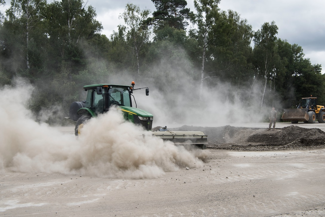 U.S. Air Force Airmen assigned to the 786th Civil Engineer Squadron move and clear out dirt during legacy crater repair training during Silver Flag