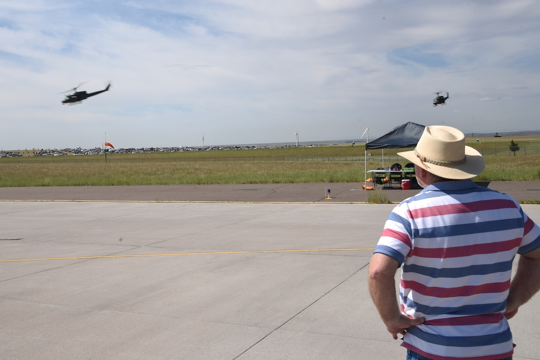 spectators watch helicopters