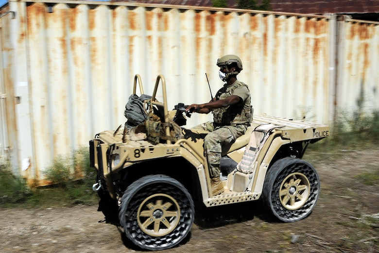 Airman 1st Class Franklin Simon, a 164th Security Forces Squadron defender, Memphis Tennessee Air National Guard, drives an all-terrain vehicle while acting as the opposition forces in a joint exercise with the Army infantry, Air Force tactical air control party, and joint terminal air controllers during Northern Strike 20 at Rogers City, Mich., July 21, 2020.