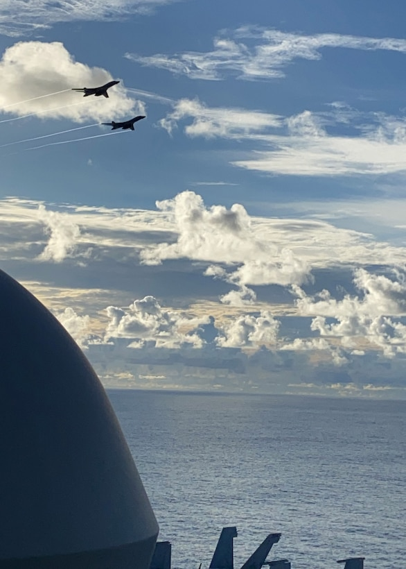 U.S. Air Force B-1B Lancers fly by the USS Ronald Reagan in the Philippine Sea during a Bomber Task Force mission, July 21, 2020. Strategic bomber missions contribute to the joint lethality and readiness of the U.S. Air Force and its allies and partners throughout the Indo-Pacific region. (Courtesy Photo by U.S. Navy)