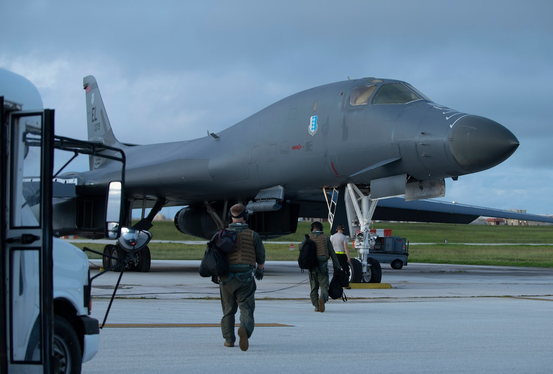 Aircrew, assigned to the 37th Expeditionary Bomb Squadron, prepare to board a B-1B Lancer at Andersen Air Force Base, Guam, prior to a Bomber Task Force mission in the South China Sea, July 21, 2020. Long range, long duration missions demonstrate the U.S. Air Force's unwavering commitment to our allies and partners in the Indo-Pacific region. (U.S. Air Force Photo by Airman 1st Class Christina Bennett)