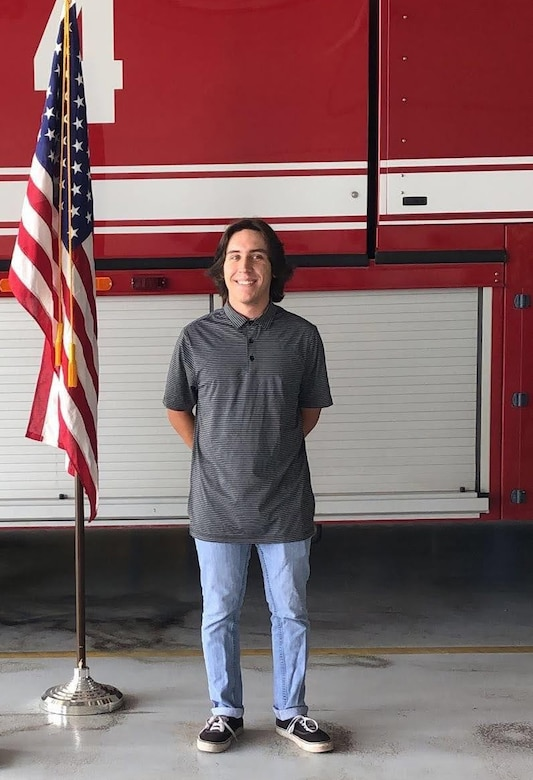 Connor Tabarini stands in front of a fire engine at the Idaho Air National Guard's Gowen Field, after enlisting as a fireman in the Air Force Reserve.