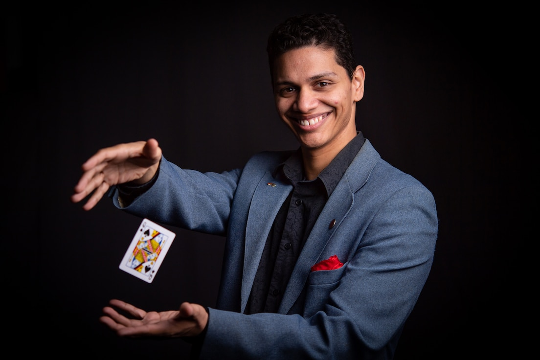Photo of Airman performing magic