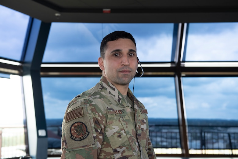 U.S. Air Force Tech. Sgt. Erron Sayas, 52nd Operational Support Squadron air traffic control watch supervisor, poses for a photo at Spangdahlem Air Base, Germany, July 17, 2020. Sayas is credited for preventing a disaster on the flightline between a C-17 Globemaster III aircraft and a flightline sweeper vehicle. (U.S. Air Force photo by Airman 1st Class Alison Stewart)