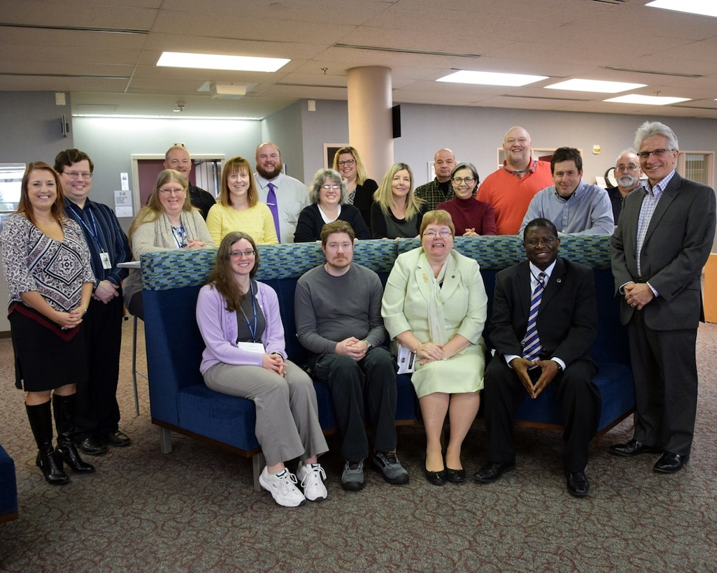 D'Azzo Research Library staff and leadership gathered in honor of National Library Worker's Day in April 2018.  The joint AFIT/AFRL library received the 2019 Federal Library/Information Centers of the Year award in the large library/information center category. (U.S. Air Force photo by Katie Scott)