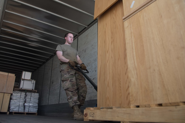 Tech. Sgt. Jeffrey Melton, 22nd Logistics Readiness Squadron flight services center supervisor, loads a pallet of equipment July 22, 2020, at McConnell Air Force Base, Kansas. The Defense Reutilization and Marketing Services provides savings by avoiding Department of Defense procurement and repair costs and is a benefit to the military and other federal agencies.(U.S. Air Force photo by Airman 1st Class Marc A. Garcia)