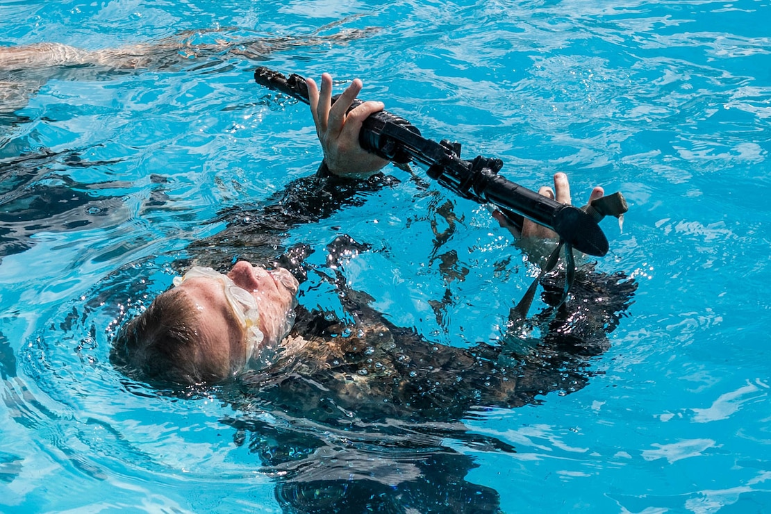 A U.S. Marine participates in a water survival screening at Camp Shelby, Miss., on July 19.