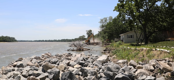 U.S. Army Corps of Engineers, Omaha District employees and contractors repair a scour hole on the Platte River near Thomas Lakes in Marble, Nebraska, June 16. (Photo by Nyime Gilchrist)