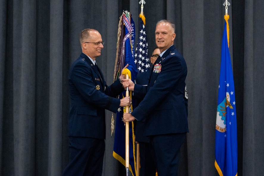 Col. Michael A. Miller, right, outgoing 2nd Bomb Wing commander, relinquishes the guidon to Maj. Gen. Mark E. Weatherington, left, 8th Air Force and Joint-Global Strike Operations Center commander, during a change of command ceremony at Barksdale Air Force Base, La., July 23, 2020. The passing of a squadron's guidon symbolizes a transfer of command. (U.S. Air Force photo by Airman 1st Class Jacob B. Wrightsman)