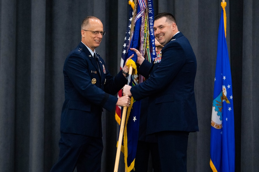 Col. Mark C. Dmytryszyn, right, incoming 2nd Bomb Wing commander, receives the guidon from Maj. Gen. Mark E. Weatherington, 8th Air Force and Joint-Global Strike Operations Center commander, during a change of command ceremony at Barksdale Air Force Base, La., July 23, 2020. The passing of a squadron's guidon symbolizes a transfer of command. (U.S. Air Force photo by Airman 1st Class Jacob B. Wrightsman)