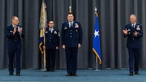 Maj. Gen. Mark E. Weatherington, left, 8th Air Force and Joint-Global Strike Operations Center commander, and Col. Michael A. Miller, right, outgoing 2nd Bomb Wing commander, congratulate Col. Mark C. Dmytryszyn, middle, incoming 2nd BW commander, during a change of command ceremony at Barksdale Air Force Base, La., July 23, 2020. A change of command is a military tradition that represents a formal transfer of authority and responsibility for a unit from one commanding or flag officer to another. (U.S. Air Force photo by Airman 1st Class Jacob B. Wrightsman)