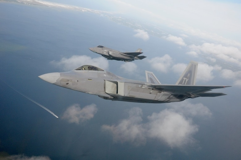 Manned aircraft, such as this F-22 Raptor or F-35 Lightning II, could one day operate with autonomous attritable unmanned aircraft acting as wingmen. The award of the Skyborg Prototyping, Experimentation and Autonomy Development indefinite-delivery/indefinite-quantity contract sets the stage to begin prototyping and operational experimentation for the Skyborg Vanguard program. (U.S. Air Force photo/1st Lt. Savanah Bray)