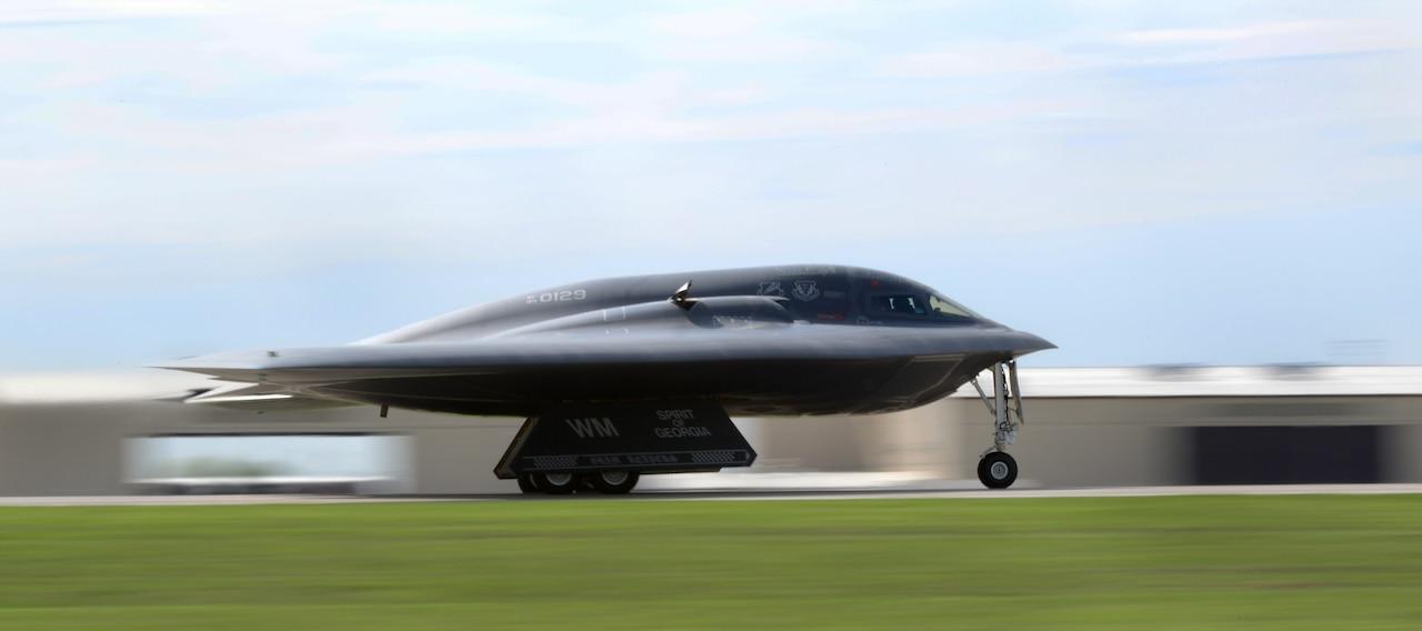 A wing-shaped aircraft moves down a runway.