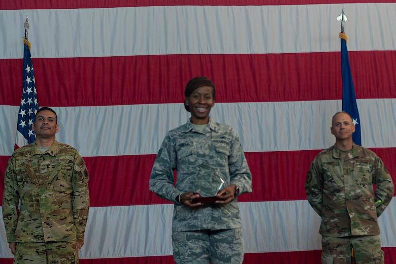 Photo of an Airman receiving an award