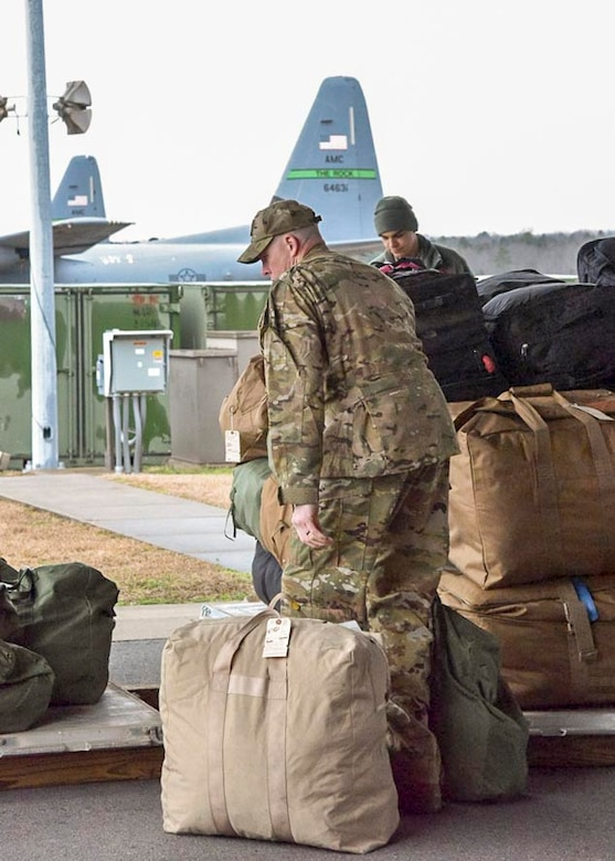 Lt. Col. Scott Lawson, 913th Airlift Group chief of safety, places his luggage on top of a cargo pallet to be loaded onto a C-130J at Little Rock Air Force Base, Ark., on Jan. 28, 2019.  The 913th Airlift Group airlift and maintenance personnel deployed together to provide combat airlift to support Operations Inherent Resolve, New Dawn, and Freedom's Sentinel.  Nearly 80 percent of the unit are traditional reservists who live across the state and train one weekend a month, two-weeks a year.  (U.S. Air Force Reserve photo by Maj. Ashley Walker)