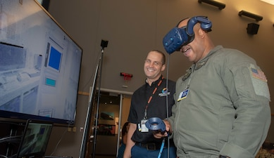 Senior chief uses virtual reality to manipulate a hardware rack