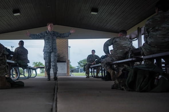 Senior Airman Shaylee Chiavola, 22nd Civil Engineer Squadron emergency management journeyman, teaches a Chemical, Biological, Radiological and Nuclear survival skills class, July 21, 2020, at McConnell Air Force Base, Kansas. The emergency management team instructs approximately 200 CBRN classes annually to prepare Airmen to operate in a CBRN warfare environment. (U.S. Air Force photo by Senior Airman Alexi Bosarge)