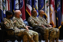 four soldiers sitting in a line.