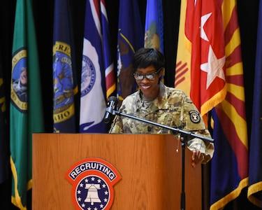 a female soldier giving a speech.