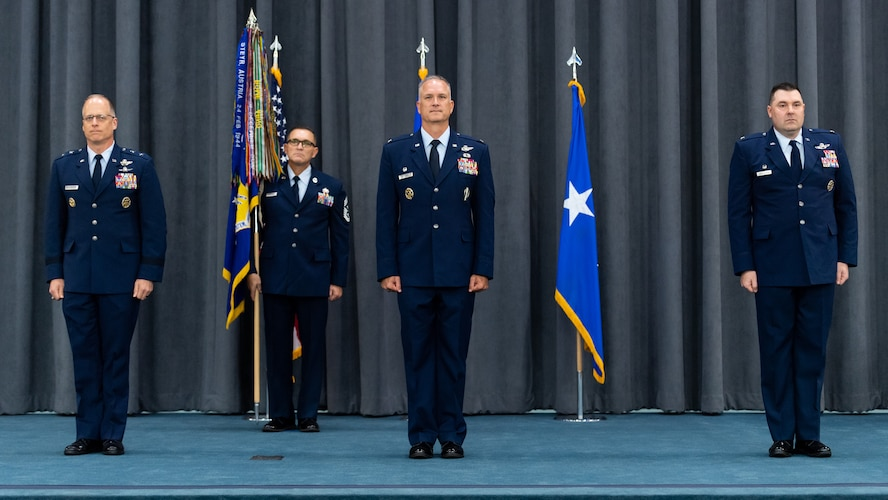 Maj. Gen. Mark E. Weatherington, 8th Air Force and Joint-Global Strike Operations Center commander, Col. Michael A. Miller, outgoing 2nd Bomb Wing commander, and Col. Mark C. Dmytryszyn, incoming 2nd BW commander, stand at the position of attention during a change of command ceremony at Barksdale Air Force Base, La., July 23, 2020. A change of command is a military tradition that represents a formal transfer of authority and responsibility for a unit from one commanding or flag officer to another. (U.S. Air Force photo by Airman 1st Class Jacob B. Wrightsman)