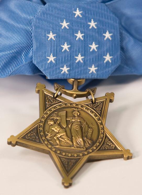 Britt Slabinski's medal of honor folded neatly on the table