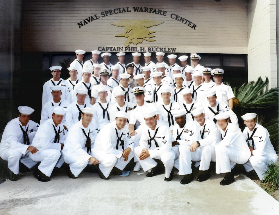 MA2 MICHAEL A. MONSOOR, USN with sailors posing for the photo