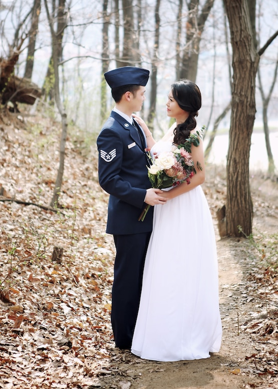 U.S. Air Force Tech. Sgt. Samuel Han, 316th Training Squadron instructor and bride, Erin, pose for a wedding photo in 2014. The two met while Han was on a military assignment in South Korea. (Courtesy photo)