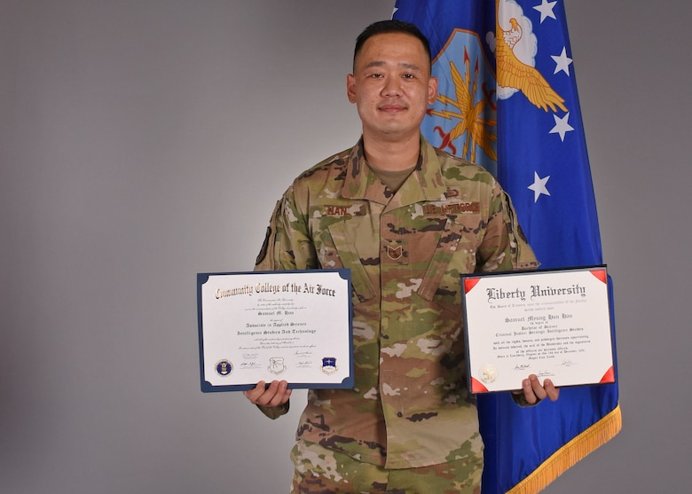 U.S. Air Force Tech. Sgt. Samuel Han, 316th Training Squadron instructor, displays two degrees he achieved while serving active duty, in the Public Affairs photo studio, on Goodfellow Air Force Base, Texas, July 15, 2020. Han's life and Air Force career started out with adversity, but through positive mentorship, and actively seeking opportunities, he overcame his misfortunes. (U.S. Air Force photo by Airman 1st Class Abbey Rieves)
