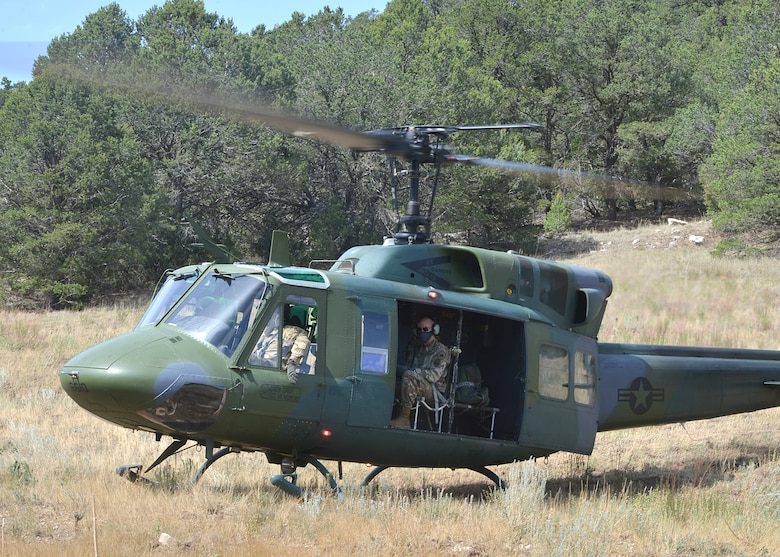 U.S. Air Force Maj. Gen. Michael J. Lutton 20th Air Force commander, is transported  in a UH-1N Huey.