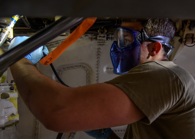 U.S. Air Force Airman 1st Class Sebastian Colon, a 35th Maintenance Squadron Phase Inspection section journeyman, applies gear lube to the F-16 Fighting Falcon at Misawa Air Base, Japan, July 22, 2020. To ensure the aircraft is in the best condition at the end of phase maintenance, the team also works closely with the other flightline shops. (U.S. Air Force photo by Airman 1st Class China M. Shock)
