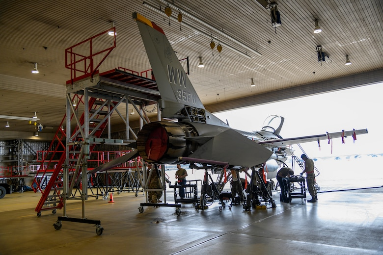 U.S. Air Force Airmen from the 35th Maintenance Squadron Phase Inspection section inspect an F-16 Fighting Falcon at Misawa Air Base, Japan, July 22, 2020. The 35th MXS Phase Inspection section Airmen thoroughly inspect and identify discrepancies before they become big problems, allowing Misawa jets to be at the ready for the mission. (U.S. Air Force photo by Airman 1st Class China M. Shock)