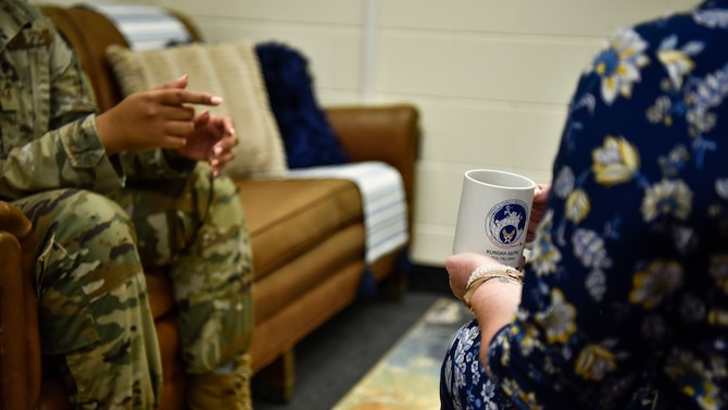A photo of a military counselor speaking to an Airman.