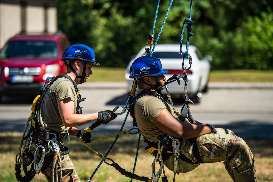 Photo of Airmen conducting tower rescue training