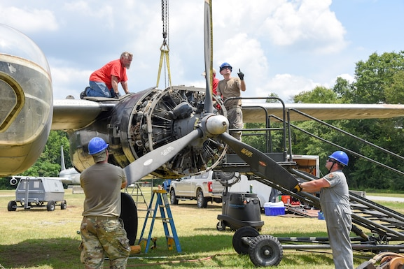 Members of the 117th Maintenance Group disassemble an A-26 Invader at the Museum of Aviation, Warner Robins, Ga., June 22, 2020. This aircraft will be relocated to Sumpter Smith Joint National Guard Base, Birmingham, Ala. (U.S. Air National Guard photo by: Tech. Sgt. Jim Bentley)