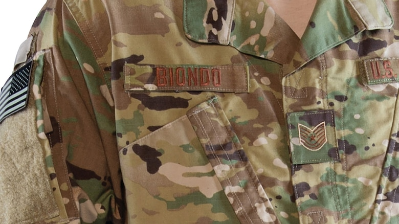 OCP rank insignia, badges, name, and service tapes will now feature a lighter, three-color background pattern, versus the current seven-color pattern, to increase readability and ease rank recognition.