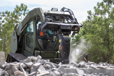 SPMAGTF-SC Marines demolish structures during demolition training at Camp Lejeune, North Carolina, to enhance their capabilities with construction and deconstruction.