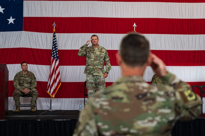 A photo of the Mission Support Group commander receiving a final salute