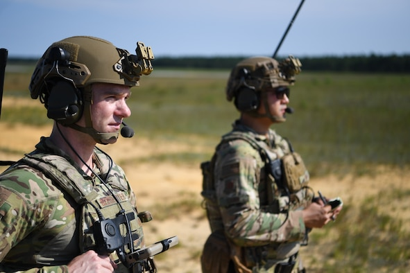 Maj. Clark Beesemyer, 621st Mobility Support Operations Squadron Air Mobility Liaison Officer, and Capt. David Chan, 621st MSOS AMLO, coordinate an aerial drop at Joint Base McGuire-Dix-Lakehurst, New Jersey, July 21, 2020. The 621st MSOS Summit is held biannually and brings together Airmen from 20 geographically separated units.