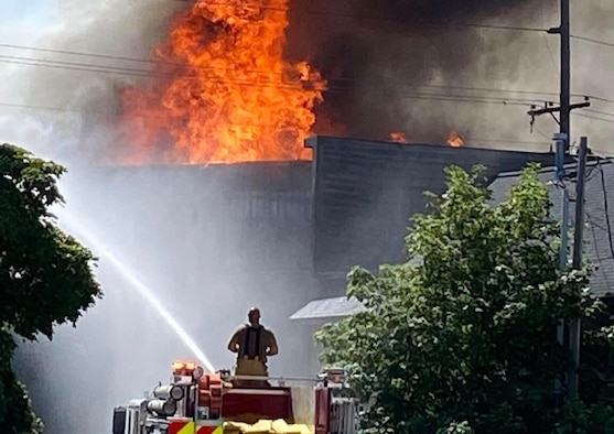 Firefighters from the Michigan Air National Guard's Alpena Combat Readiness Training Center and the New York Air National Guard's 106th Rescue Wing respond to a request for mutual-aid support at a massive structure fire in downtown Alpena, Michigan, July 21, 2020.