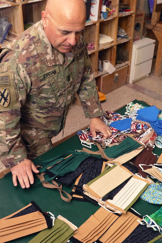 U.S. Army 1st Sgt. Richard F. Jordan, 248th Medical Company (Area Support), looks though some of the estimated 2,000 handmade cloth masks sent from the United States to the unit at Al Asad Air Base, Iraq, May 13, 2020. Troops and civilians at the base were able to use the masks to help prevent the spread of COVID-19. Coalition Forces remain united and determined in their mission to degrade and defeat Daesh. (U.S. Army by Sgt. 1st Class Gary A. Witte)