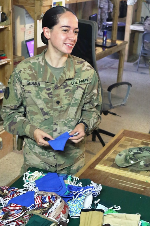 U.S. Army Spc. Victoria Guzman, 248th Medical Company (Area Support) pharmacy NCOIC, looks though some of the handmade cloth masks sent from the United States to the unit at Al Asad Air Base, Iraq, May 13, 2020. Troops and civilians at the base were able to use the masks to help prevent the spread of COVID-19. Coalition Forces remain united and determined in their mission to degrade and defeat Daesh. (U.S. Army by Sgt. 1st Class Gary A. Witte)