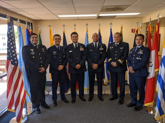 International and American service members, Professional Military Education instructors, pose for a photo at the IAAFA headquarters building. From left to right, Major Ronand Castillo from El Salvador, Major Marcio Teixeira from Brazil, Major Eduardo Barajas, a flight commander from the US Air Force, Master Sgt. Aguedo Mendez a flight chief from the US Air Force, Chief Master Sgt. Elvis Garcia from Peru, and Master Sgt. Edwin Lara from Honduras.