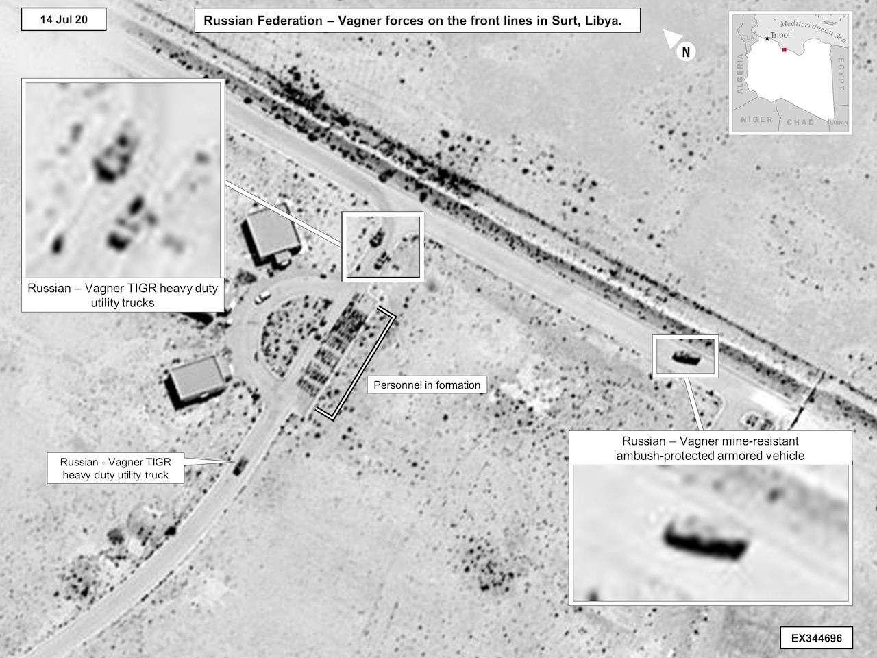 An aerial photo shows military equipment on the ground.