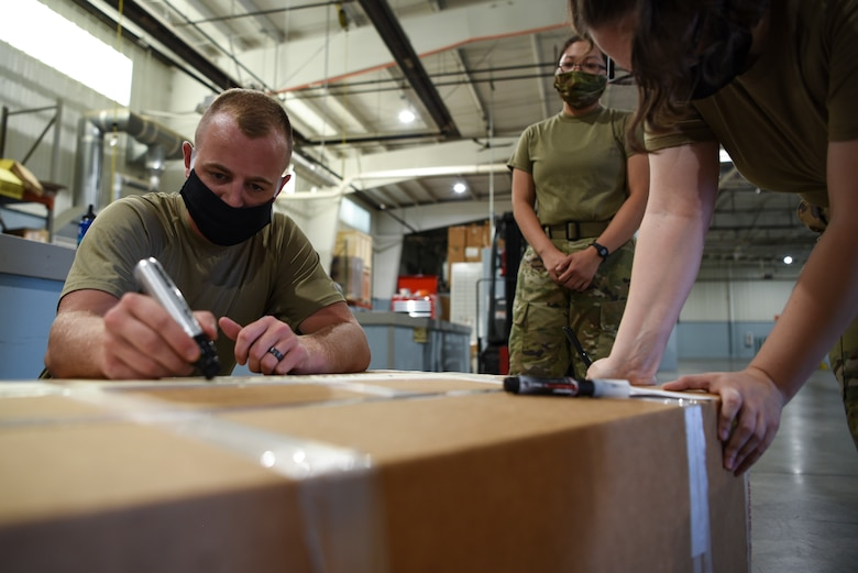 Airmen marking boxes
