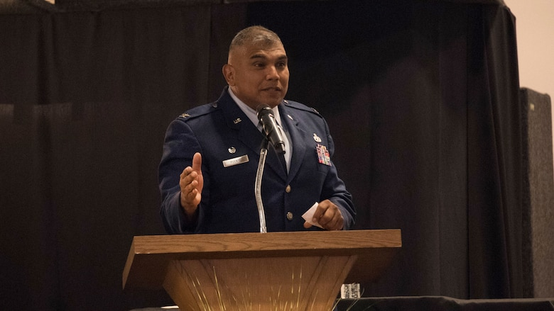 Col. Anthony Puente speaks during 982nd TRG change of command